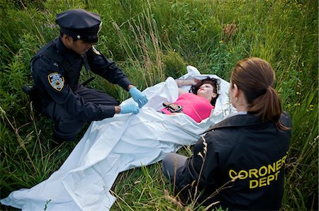 dead female body - Police Officers with Woman's Body in Field, Toronto, Ontario, Canada Stock Photo - Rights-Managed, Code: 700-02348165