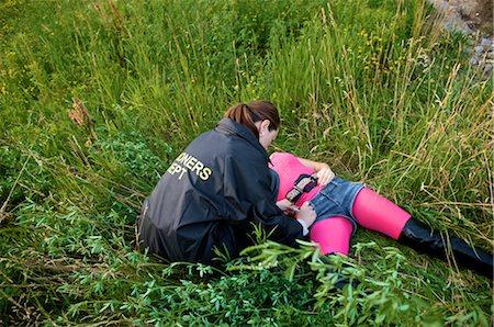 dead female body - Coroner Examining Woman's Body in Field, Toronto, Ontario, Canada Stock Photo - Rights-Managed, Code: 700-02348160