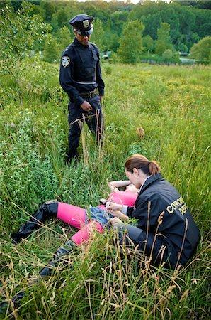 dead female body - Coroner Examining Woman's Body in Field, Toronto, Ontario, Canada Stock Photo - Rights-Managed, Code: 700-02348161