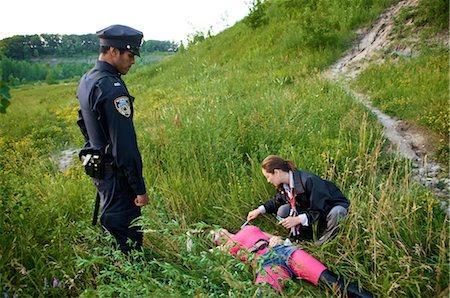 Coroner Examining Woman's Body in Field, Toronto, Ontario, Canada Stock Photo - Rights-Managed, Code: 700-02348162