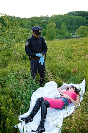 Police Officer with Woman's Body in Field, Toronto, Ontario, Canada Stock Photo - Rights-Managed, Code: 700-02348163