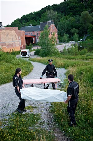 dead female body - Police Officer and Paramedics Taking Body to Ambulance, Toronto, Ontario, Canada Stock Photo - Rights-Managed, Code: 700-02348171