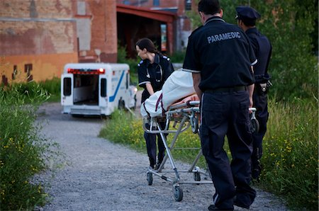 dead female body - Police Officer and Paramedics Taking Body to Ambulance, Toronto, Ontario, Canada Stock Photo - Rights-Managed, Code: 700-02348172
