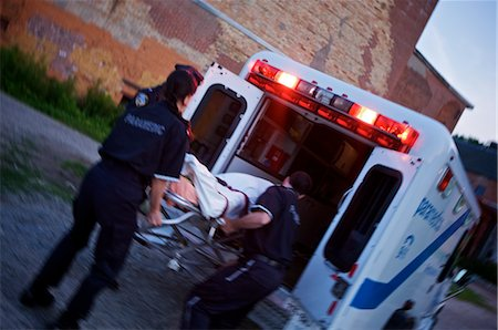 dead female body - Police Officer and Paramedics Loading Body into Ambulance, Toronto, Ontario, Canada Stock Photo - Rights-Managed, Code: 700-02348173