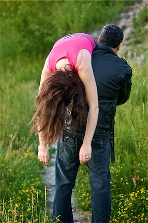 Man Carrying Woman over Shoulder, Toronto, Ontario, Canada Stock Photo - Rights-Managed, Code: 700-02348198