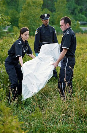 dead female body - Police and Paramedics Carrying Body Bag in Field, Toronto, Ontario, Canada Stock Photo - Rights-Managed, Code: 700-02348204