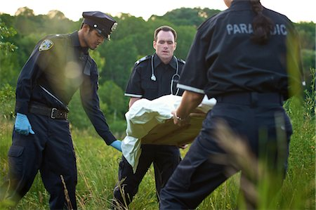 dead female body - Police and Paramedics Carrying Body Bag in Field, Toronto, Ontario, Canada Stock Photo - Rights-Managed, Code: 700-02348205
