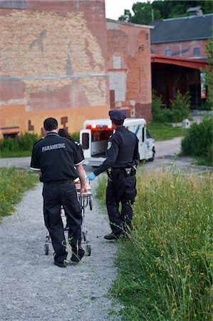 dead female body - Police Officer and Paramedics Taking Body to Ambulance, Toronto, Ontario, Canada Stock Photo - Rights-Managed, Code: 700-02348206