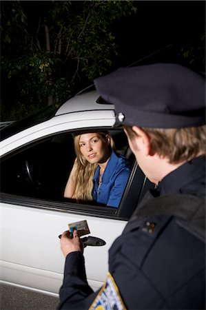 female police officer happy - Police Officer Pulling Woman Over, Toronto, Ontario, Canada Stock Photo - Rights-Managed, Code: 700-02348234