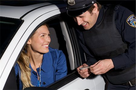 female police officer happy - Police Officer Pulling Woman Over, Toronto, Ontario, Canada Stock Photo - Rights-Managed, Code: 700-02348232