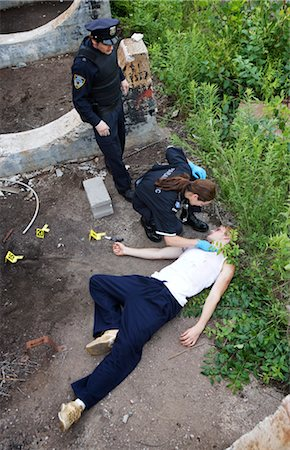 dead female body - Police Officer and Paramedic with Corpse on Crime Scene, Toronto, Ontario, Canada Stock Photo - Rights-Managed, Code: 700-02348267