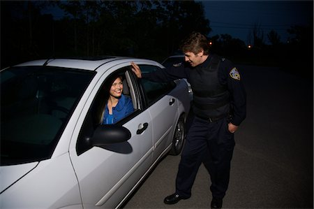 female police officer happy - Police Officer Pulling Woman Over, Toronto, Ontario, Canada Stock Photo - Rights-Managed, Code: 700-02348277
