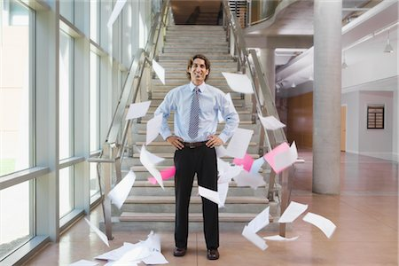 Businessman Throwing Papers Up in the Air Stock Photo - Rights-Managed, Code: 700-02348555