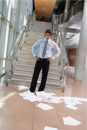 Businessman Looking at Papers Scattered on the Floor Stock Photo - Rights-Managed, Code: 700-02348557