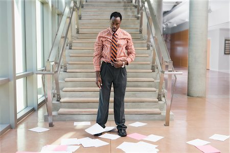 Businessman Looking at Papers Scattered on the Floor Stock Photo - Rights-Managed, Code: 700-02348553