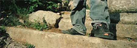 Close-up of Boy's Shoes With Big Toe Sticking Out Stock Photo - Rights-Managed, Code: 700-02348603