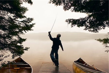 Boy Fishing Off Dock Early in the Morning, Algonquin Park, Ontario, Canada Stock Photo - Rights-Managed, Code: 700-02348736