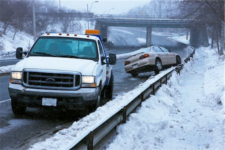Tow Truck and Car Stuck on Guard Rail on Icy Highway, Toronto, Ontario, Canada Stock Photo - Rights-Managed, Code: 700-02348737