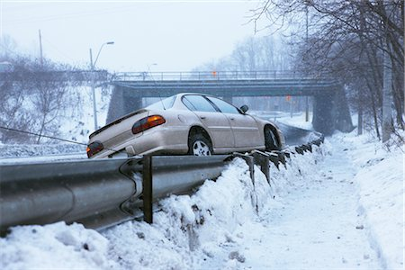 Tow Truck Pulling Car Off Guard Rail on Icy Highway, Toronto, Ontario, Canada Stock Photo - Rights-Managed, Code: 700-02348738