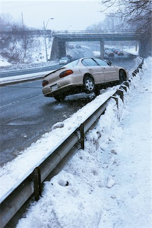 Tow Truck Pulling Car Off Guard Rail on Icy Highway, Toronto, Ontario, Canada Stock Photo - Rights-Managed, Code: 700-02348739