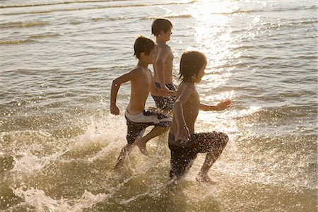Boys Running in the Water Stock Photo - Rights-Managed, Code: 700-02348772