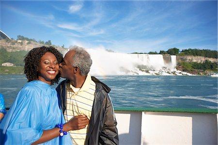 Couple in Boat by Niagara Falls, Niagara Falls, Ontario, Canada Stock Photo - Rights-Managed, Code: 700-02376805