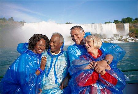 Couple in Boat by Niagara Falls, Niagara Falls, Ontario, Canada Stock Photo - Rights-Managed, Code: 700-02376809