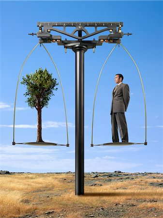 Businessman and Tree on Balance Scale Stock Photo - Rights-Managed, Code: 700-02377640