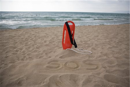 Lifeguard's Floatation Device on the Beach, SOS Written in the Sand, Mallorca, Baleares, Spain Stock Photo - Rights-Managed, Code: 700-02371179