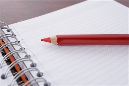 school desk - Close-up of Red Pencil and Day Planner Stock Photo - Rights-Managed, Code: 700-02371526