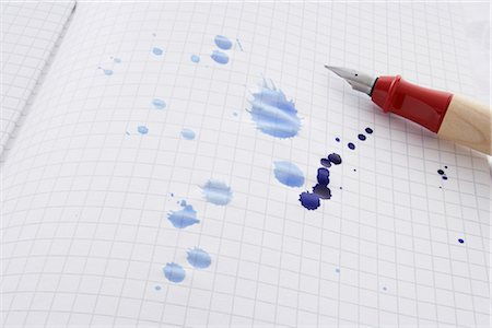 Leaking Pen Leaving Ink Spots on Paper Stock Photo - Rights-Managed, Code: 700-02371539