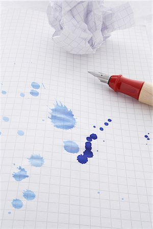 Leaking Pen Leaving Ink Spots on Paper Stock Photo - Rights-Managed, Code: 700-02371540