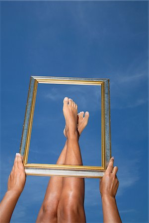 Woman Framing her Feet Stock Photo - Rights-Managed, Code: 700-02371604