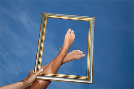 Woman Framing her Feet Stock Photo - Rights-Managed, Code: 700-02371605