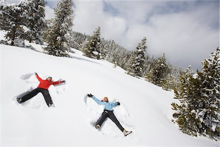 Couple Making Snow Angels, Breckenridge, Colorado, USA Stock Photo - Rights-Managed, Code: 700-02386056