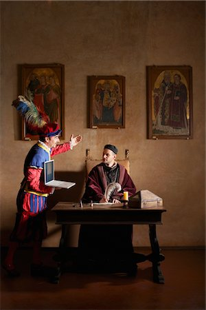 Medieval Servant Presenting Laptop Computer to Lord, Mugello, Tuscany, Italy Stock Photo - Rights-Managed, Code: 700-02428444