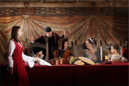 Maid Vaccuming Crumbs from Medieval Dinner Table, Mugello, Tuscany, Italy Stock Photo - Rights-Managed, Code: 700-02428445