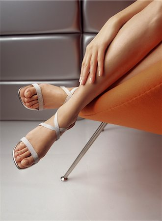 Legs of Woman in Chair Stock Photo - Rights-Managed, Code: 700-02428545