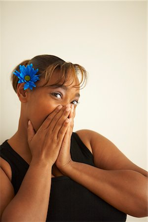 fat black woman - Woman Covering Mouth with Hands Stock Photo - Rights-Managed, Code: 700-02428835