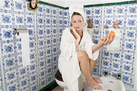 Woman Looking at Self with Compact Mirror Stock Photo - Rights-Managed, Code: 700-02461370