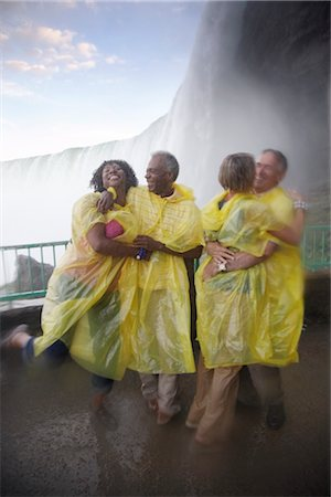 People Having Fun in the Mist Under Niagara Falls, Ontario, Canada Stock Photo - Rights-Managed, Code: 700-02461625