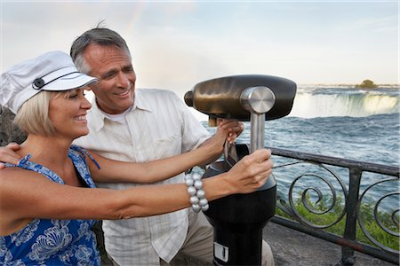 Couple Looking Through Viewfinder at Niagara Falls, Ontario, Canada Stock Photo - Rights-Managed, Code: 700-02461626