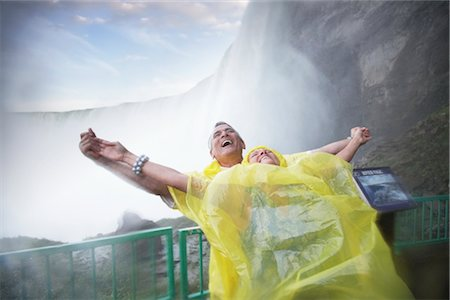 Couple Having Fun in the Mist Under Niagara Falls, Ontario, Canada Stock Photo - Rights-Managed, Code: 700-02461629