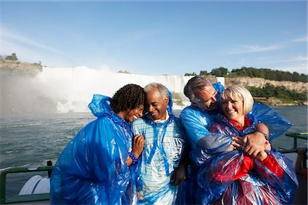 Couples Embracing Aboard the Maid of the Mist, Niagara Falls, Ontario, Canada Stock Photo - Rights-Managed, Code: 700-02461635
