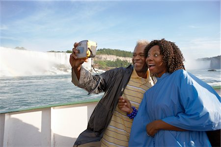 Couple Taking a Picture of Themselves Aboard The Maid of the Mist, Niagara Falls, Ontario, Canada Stock Photo - Rights-Managed, Code: 700-02461630