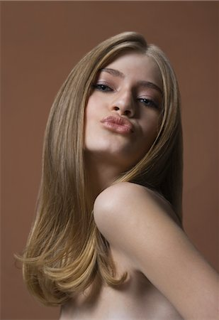 Woman Puckering Lips Stock Photo - Rights-Managed, Code: 700-02519126