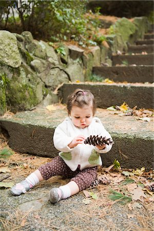 Girl with Pine Cone by Stone Steps Stock Photo - Rights-Managed, Code: 700-02586125