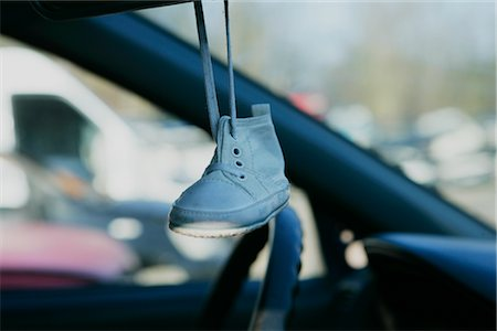 Baby's Shoe Hanging from Mirror in Wrecked Car Stock Photo - Rights-Managed, Code: 700-02594298
