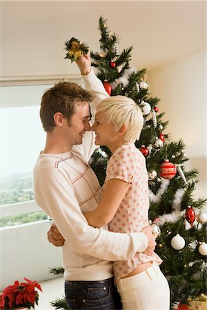 Couple Kissing Under the Mistletoe Stock Photo - Rights-Managed, Code: 700-02594328