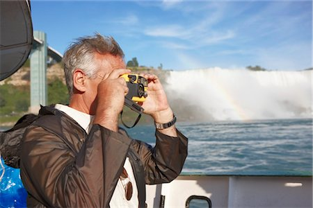 Man Taking Pictures of Niagara Falls, Ontario, Canada Stock Photo - Rights-Managed, Code: 700-02593645